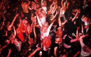 epa05005783 Visitors of the danceparty Blood Rave are dancing under a shower of blood in Amsterdam, The Netherlands, 01 November 2015. This Blood Rave is held for the first time in the Netherlands.  EPA/REMKO DE WAAL