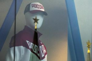 A mannequin dressed in a Russian Olympics National team uniform is on display in a shop window, with the Kremlin tower star reflected on a window glass, in Moscow, Russia, Tuesday, July 19, 2016. The Executive Board of the International Olympic Committee meets Tuesday by teleconference to rule on what action to take against Russia for the mass doping program confirmed by the world anti-doping agency on Monday. (ANSA/AP Photo/Pavel Golovkin) [CopyrightNotice: Copyright 2016 The Associated Press. All rights reserved. This material may not be published, broadcast, rewritten or redistribu]