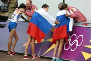 FILE - In this Aug. 11, 2012 file photo Russia coach Alexey Melnikov congratulates Olga Kaniskina, right, and Russia men's gold medalist Sergey Kirdyapkin congratulates Anisya Kirdyapkina, left, after the women's 20-kilometers race walk at the 2012 Summer Olympics in London. Russia gold-medalist Elena Lashmanova stands at center. Russia lost its appeal Thursday, July 21, 2016 against the Olympic ban on its track and field athletes, a decision which could add pressure on the IOC to exclude the country entirely from next month's games in Rio de Janeiro. The Court of Arbitration for Sport rejected the appeal of 68 Russian athletes seeking to overturn the ban imposed by the IAAF following allegations of state-sponsored doping and cover-ups. (ANSA/AP Photo/Sergei Grits, file) [CopyrightNotice: Copyright 2016 The Associated Press. All rights reserved. This material may not be published, broadcast, rewritten or redistribu]