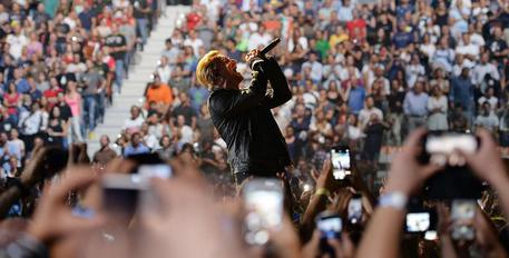 Bono Vox, leader of Irish rock band U2, performs at 'Pala Alpitour', Turin, during their European Tour first stage, 4 September 2015. ANSA/ALESSANDRO DI MARCO