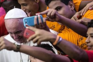 Pope Francis makes a selfie with some participants during his weekly general audience, in the Paul VI Hall, Vatican City, 03 August 2016. ANSA/ ANGELO CARCONI