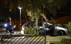 epa05556060 Police technicians examine the car the injured were traveling in after a shooting in the southern part of Malmo, Sweden, 25 September 2016. A major police operation was underway after at least four people have been injured in a shooting. No further details were confirmed by the police yet.  EPA/EMIL LANGVAD SWEDEN OUT