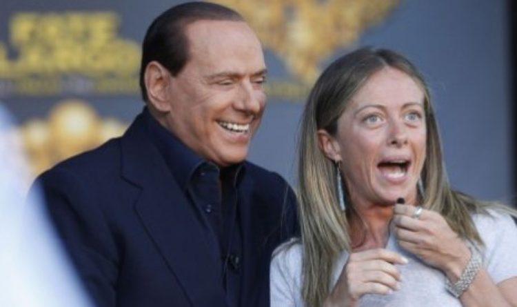 Berlusconi e Meloni indicando il ritorno alle urne